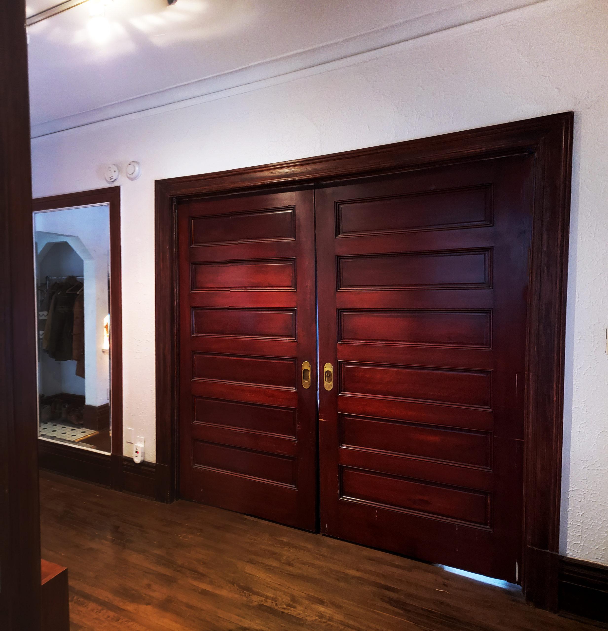 Bracken House - solid oak pocket doors.
