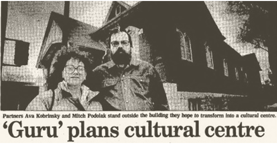 Newspaper clipping of Mitch Podoluck and Ava Kobrinsky in front of the centre