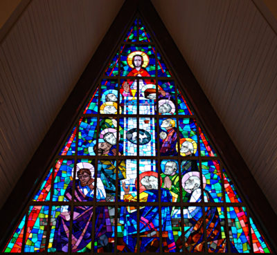 A stained glass window made by Leo Mol that depicts the Last Supper