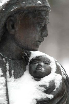 A Leo Mol sculpture depicting a mother and child.